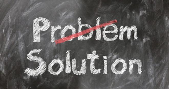 Ckalk board illustrating the words solution overriding problem.