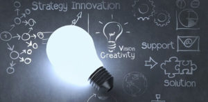 Picture of a light illuminating the words strategy innovation, creativity and solution.