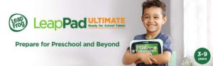 The picure of a very happy little boy, holding on to his Leap Ultimate, fun learning tablet.