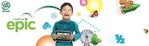 The picture of a little boy, holding on to his leapad epic 7, fun learning tablet.