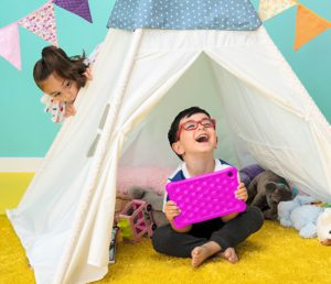 Children in a tent happily holding their LeapPad 2 explorer kid's tablet.