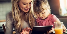 The picture of a mother and little girl, engaging their fun learning tablet.