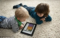 The picture of two litle children, engaging their fun learning tablet.