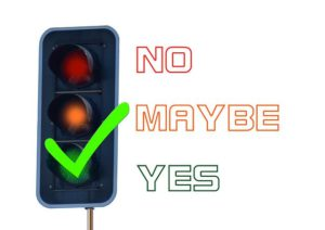 The illustration of a traffic signal showing green, and stating yes.